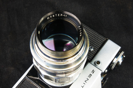 DONETSK, UKRAINE - May 07, 2016: old soviet film SLR camera Zenit - B with lens Jupiter-11, for use with 35 mm film, made in USSR in 1968 - 1973, manufactured by KMZ, with original leather case