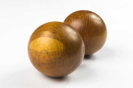 pair of wooden Chinese singing balls Baoding of health for hands on white background