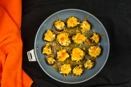 healthful: Royal baked stuffed mushrooms champignons with cheese in the pan