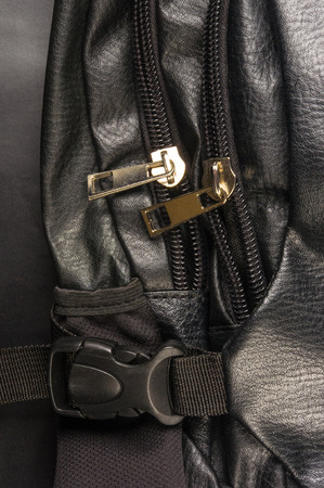 seams: closeup of the fittings and seams on black leather backpack