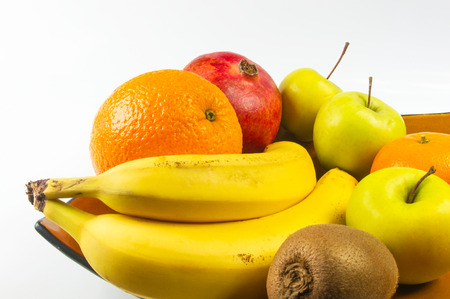 Assortment of exotic fruits on white background