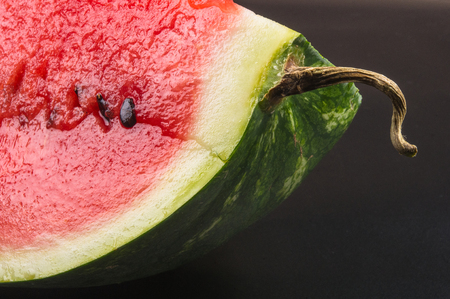 a quarter of a ripe watermelon on a black background Stock Photo