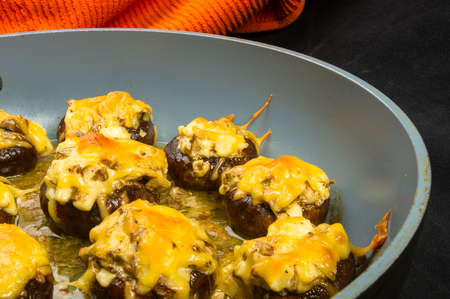 Royal baked stuffed mushrooms champignons with cheese in the pan