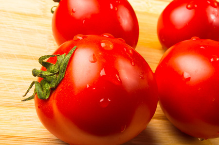 grower: still life - ripe small tomatoes on wooden background