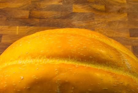 still life - ripe juicy Ethiopian melon on wooden background Stock Photo