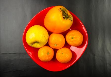 Assortment of exotic fruits on black background