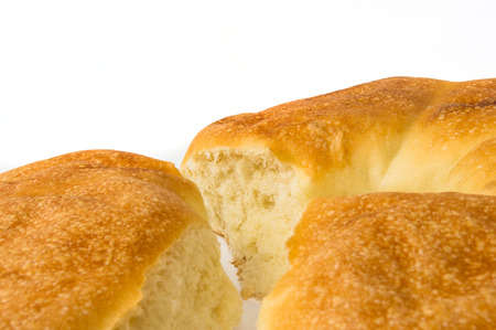 broken unleavened wheat cake on a white background Stock Photo