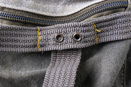 closeup of buckles, clasps, zippers, pockets, fasteners, fittings and seams in the green backpack