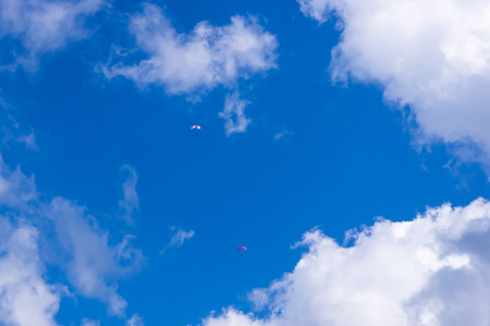 paragliders in flight in the sky with clouds Stock Photo