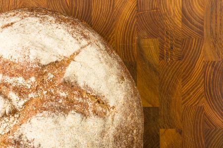 cut malt bread handmade on wooden background Stock Photo