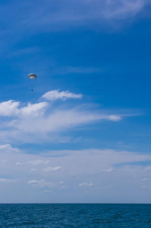 dropping parachutists from a helicopter over the sea