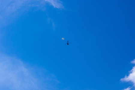 parachutists: dropping parachutists from a helicopter