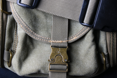 closeup of buckles, clasps, zippers, pockets, fasteners, fittings and seams on the hand bag of coarse cotton fabric Stock Photo