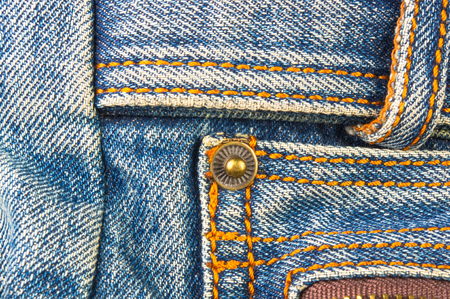 closeup of buckles, clasps, zippers, pockets, fasteners, fittings and seams on the jeans hand bag Stock Photo