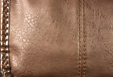 closeup of buckles, clasps, zippers, pockets, fasteners, fittings and seams on brown leather hand bag Stock Photo