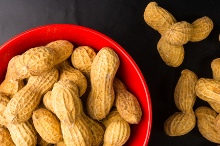 Peanuts in shell on dark background, close up Stock Photo