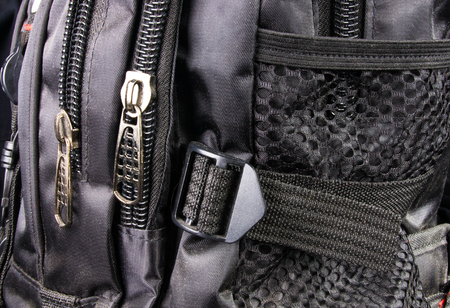 durable: closeup of the fittings and seams in the black backpack Stock Photo