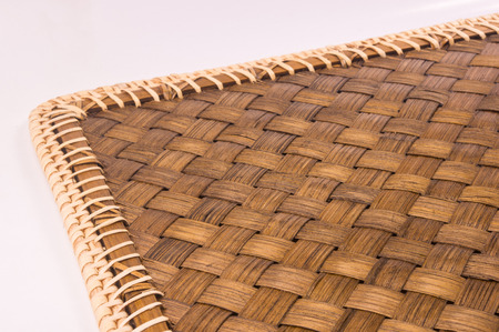 stripping: braided brown rattan Mat - stand food, close-up, macro Stock Photo