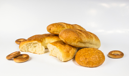set whole wheat breads, unleavened wheat cake and bun on white background