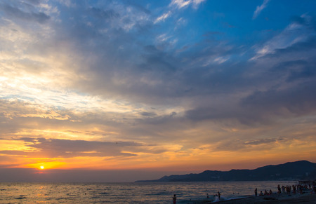 Summer sea sunset, the sun, waves and clouds, beautiful dramatic lighting