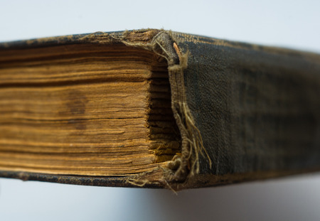 Part of the old tattered books with yellowed pages, macro, close up