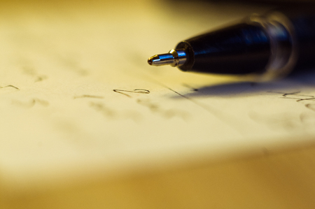 ball point pen and a sheet of paper with the inscription, macro, close up
