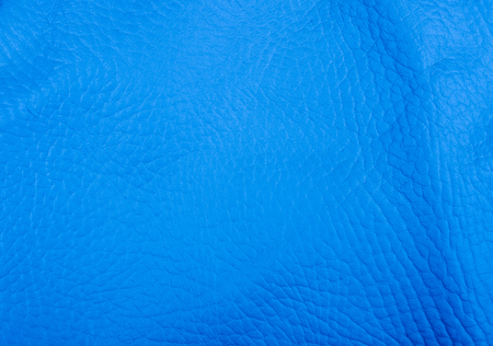blue natural leather texture background, closeup, macro Фото со стока
