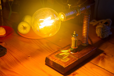 Light fixture handmade in vintage style, wooden case and radio tube, copper finish, led lamp