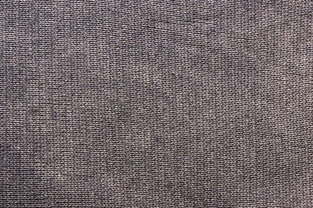 texture of a washed thick knit fabric, with decorative elements, seams and stitching, close-up Foto de archivo
