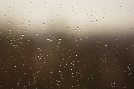 raindrops on the window glass, toned, close up