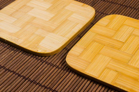 brown bamboo Mat - stand food with bamboo stands for hot, close-up, macro, wooden background