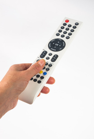 hand holding a remote control on white background 版權商用圖片