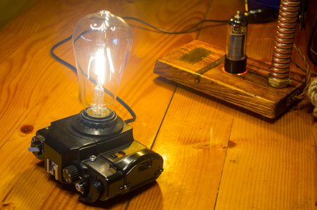 Light fixtures handmade in vintage style, retro film SLR camera case and wooden case, led lamps 写真素材