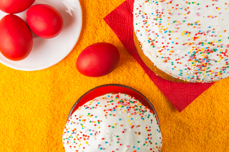 Kulichi, traditional Russian Easter cake with icing and dyed eggs