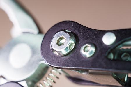 elements small foldable steel multitool, closeup, macro
