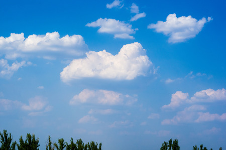 beautiful background bright blue sky with white clouds, summer day