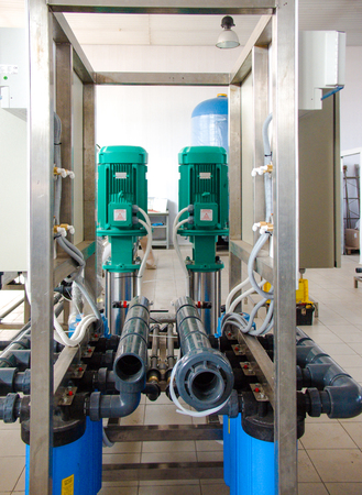 Reverse osmosis system - installation of industrial membrane devices to the purification of drinking water: pumps, pipelines, tanks, etc.