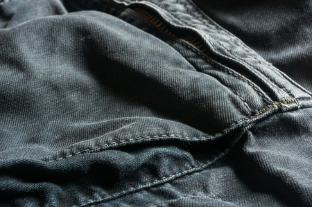 clothing items washed cotton fabric texture with seams, macro, close-up Stok Fotoğraf