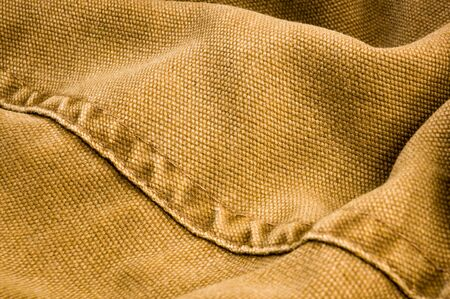 clothing items stonewashed cotton fabric texture with seams, clasps, buttons and rivets, macro Reklamní fotografie