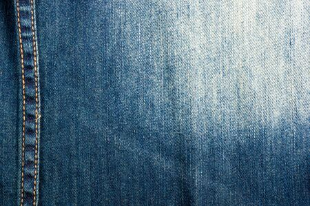 clothing items blue washed faded jeans cotton fabric texture with seams, clasps, buttons and rivets, macro