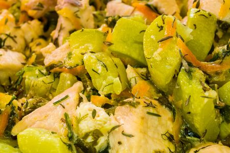 preparation of home diet dishes of white chicken meat with zucchini, carrots, onions and spices