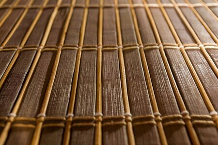 brown bamboo Mat - stand food, close-up, macro, wooden background Imagens - 133179283