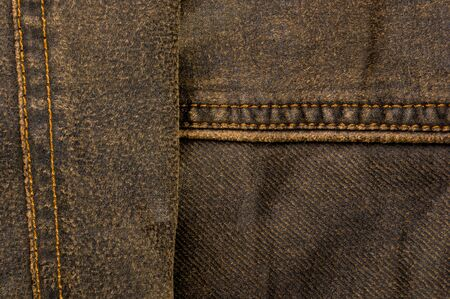 clothing items washed cotton fabric texture with seams, clasps, buttons and rivets, macro, close-up Imagens - 133552340