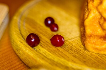 handmade preparation of treats for traditional Orthodox Christmas - dried fruits, cranberries, honey, nuts on a wooden table