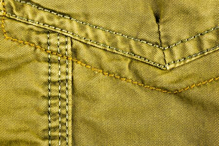 clothing items washed cotton fabric texture with seams, clasps, buttons and rivets, macro, close-up