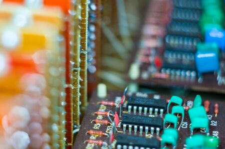 Vintage electronic circuit boards with radio parts and chips, close-up, macro photography