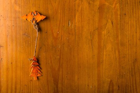 New Year Concept. Christmas decorations hand made from tangerine peel on wooden background