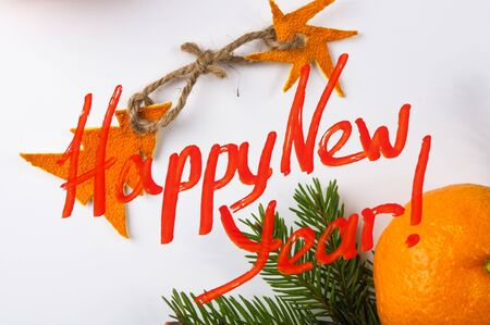 New Year Concept postcard. Christmas decorations hand made from tangerine peel and fir-tree branches with a congratulatory inscription