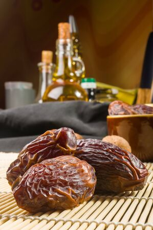 Big luxury dried date fruit on the bamboo mat, kurma ramadan kareem concept.
