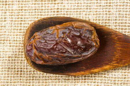 Big luxury dried date fruit ion a linen napkin, kurma ramadan kareem concept. Stock Photo